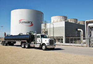 Truck driving by January Environmental plant